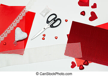 Valentines day craft top view. Handmade lace heart. DIY present. Wedding decoration. Paper, tape, beads and rhinestones