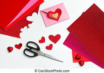 Valentines day craft top view. Handmade valentine card, DIY present. Wedding decoration. Paper, envelope and scissors