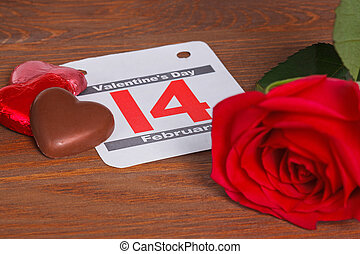 Valentines day date with red rose and chocolate