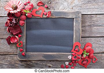 Valentines day decorations around a chalkboard