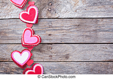Valentines day decorations on a wooden surface
