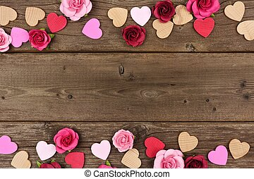 Valentines Day double border of hearts and roses against rustic wood