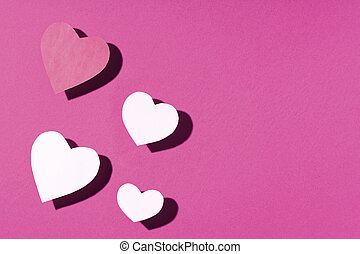 Valentine's day frame composition. Pink purple paper hearts on purple background. Top view, flat lay, copy space