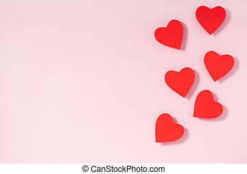 Valentine's day frame composition. Red hearts on pastel pink background. Top view, flat lay, copy space