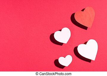 Valentine's day frame composition. Red white paper hearts on red background. Top view, flat lay, copy space
