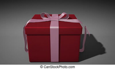 A 1080p HD Stock Video of a Valentine's Day Present unwraping itself and opening with volume light shooting out as the camera comes in to the box full of white light.