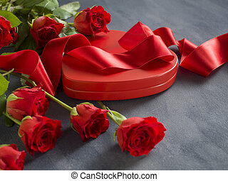 Valentine's Day, Gift box of kraft paper with a red ribbon and candles