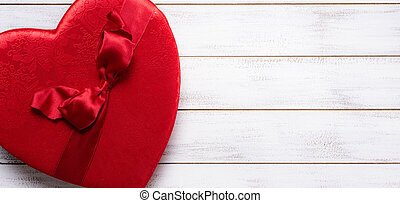 Valentine's day gift box on a white wooden background