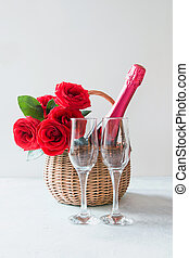 Valentine's day gift hamper, bouquet of red roses, champagnes on white.