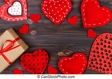 Valentines day greeting card. Handmaded hearts on wooden table. Top view, copy space