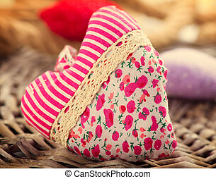 Valentine's Day. Handmade fabric heart over wood background