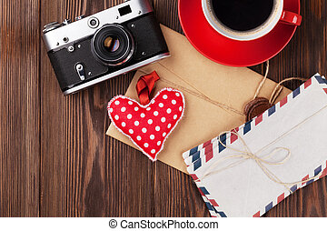 Valentines day heart, camera, coffee and letters