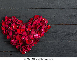 Valentines Day Heart Made of Red Roses petals on black background