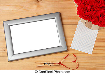 Valentines day heart shaped red ribbon and blank photo frames