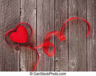 Valentines day heart shaped ribbon on wooden table