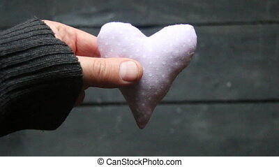 Valentines Day heart. - Valentines Day card, hand holding a...
