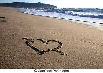 Valentine's Day heart with cross on the beach horizontal