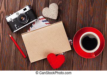 Valentines day hearts, camera, coffee and notepad