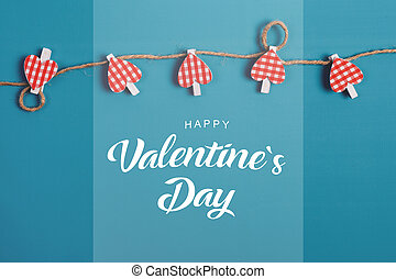 Valentines day. Hearts over blue background.
