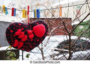 Valentines day. hearts soft pads hanging on a rope