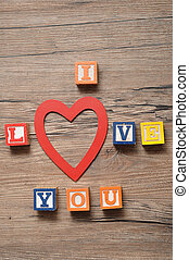 Valentine's Day. I Love you Spelled with colorful alphabet blocks and a red heart in the place of the o