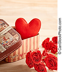 Valentines Day. Love, red heart handmade in gift box and roses