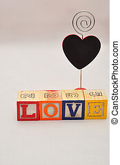 Valentine's Day. Love Spelled with colorful alphabet blocks and a black heart