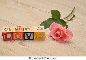 Valentine's Day. Love Spelled with colorful alphabet blocks and a pink heart