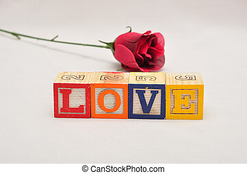 Valentine's Day. Love Spelled with colorful alphabet blocks and a red rose