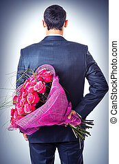 Valentines day. Man hiding behind a bouquet of flowers. Proposal scene