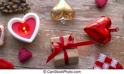 valentines day or christmas decorations on table -...