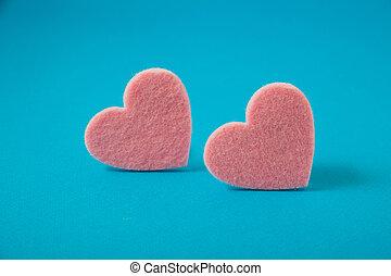 valentine's day, pink felt hearts on blue background
