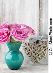 Valentine's, day. - Pink roses in a vase with a Valentine's ...