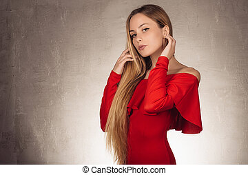 portrait of an attractive young blonde girl in red dress