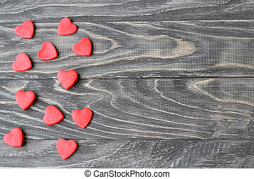 Valentine's Day . Red hearts on a wooden background.