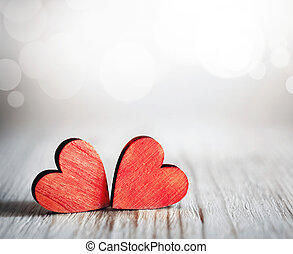 Valentines day. Red hearts on wooden background