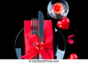 Valentine's Day romantic dinner. Table place setting over black background