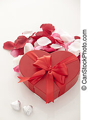 Valentines Day gift in red box with rose petal