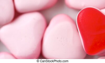 close up of pink heart shaped candies - valentines day,...