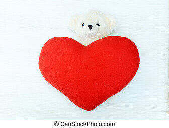 Valentines Day. Teddy bear with Red heart on wooden backgrounds above. Place for your text