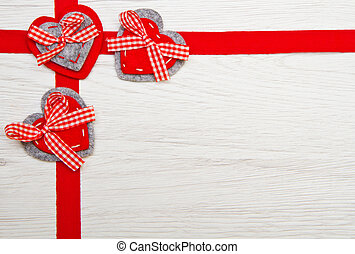 Valentines day toy heart and ribbon over wooden
