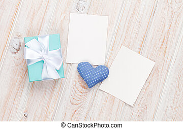 Valentines day toy heart, blank photo frames and gift box