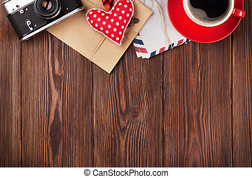 Valentines day toy heart, camera, coffee and mail on wooden...