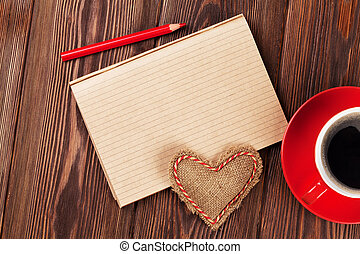 Valentines day toy heart, coffee cup and notepad
