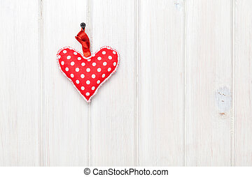 Valentines day toy heart over wooden table background