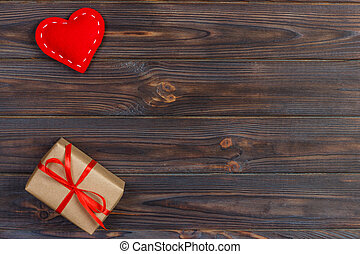 Valentines day vintage background with hearts and a gift box on wooden Table