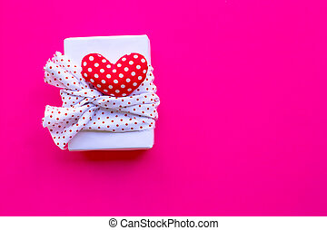 Valentine's day with gift box  on pink background. Top view