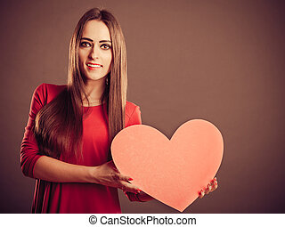 Valentines Day woman holding heart.