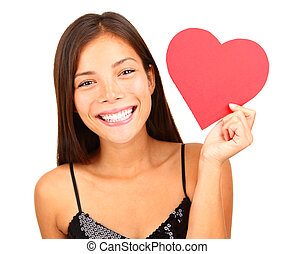 Woman holding Valentines Day heart sign with copy space. Beautiful mixed race asian / caucasian model isolated on white background.
