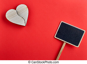 Valentines day wooden heart on red background